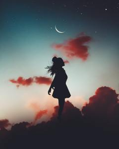 Girl silhouette with stars and moon
